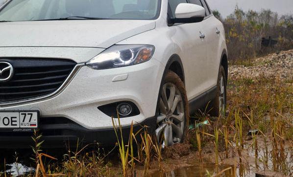 Белая CX9 в грязи
